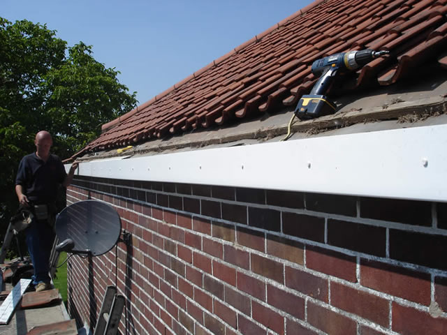 Step 3 | Installing uPVC replacement fascia board during roofline installation process