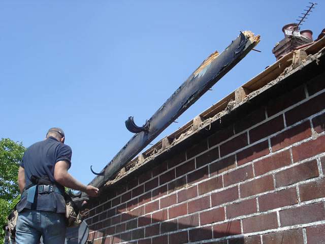 Step 1 | Remove existing fascia boards during roofline installation process