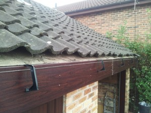 Installing gutters - brackets fitted and aligned