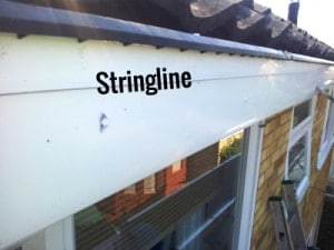Installing gutters-use stringline to align bracket positions